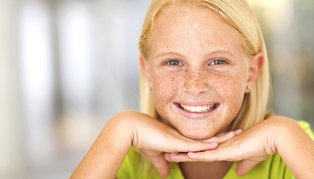 Blonde girl with freckles