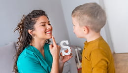 Speech therapist working with a boy