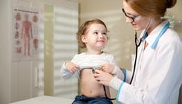Woman doctor examining child